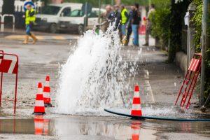 Team Working on Water Main Break Reconstruction in Raleigh